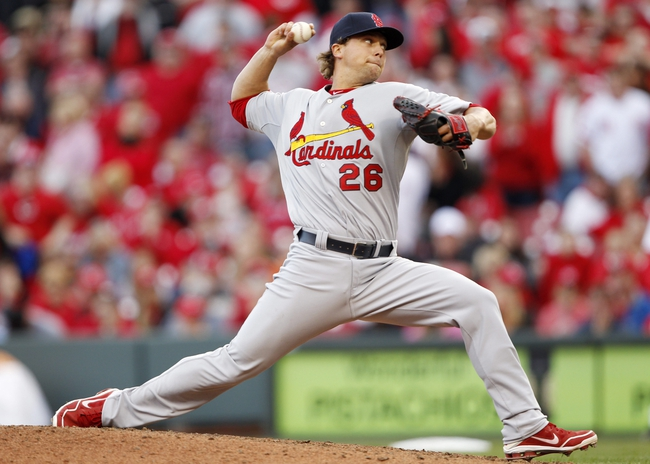 Mar 31, 2014; Cincinnati, OH, USA; St. Louis Cardinals relief pitcher Trevor Rosenthal (26) throws the ball during the ninth inning against the Cincinnati Reds at Great American Ball Park. The Cardinals won 1-0. Mandatory Credit: Frank Victores-USA TODAY Sports