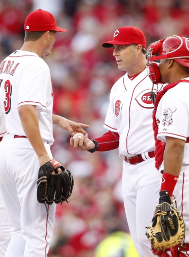 Mar 31, 2014; Cincinnati, OH, USA; Cincinnati Reds manager Bryan Price (38) relieves relief pitcher Manny Parra (43) during the eighth inning against the St. Louis Cardinals at Great American Ball Park. The Cardinals won 1-0. Mandatory Credit: Frank Victores-USA TODAY Sports