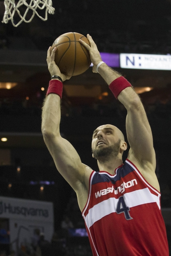 Mar 31, 2014; Charlotte, NC, USA;  Washington Wizards center Marcin Gortat (4) goes up for a shot during the first half against the Charlotte Bobcats at Time Warner Cable Arena. Mandatory Credit: Jeremy Brevard-USA TODAY Sports