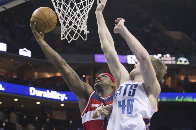 Mar 31, 2014; Charlotte, NC, USA; Washington Wizards forward Al Harrington (7) goes up for a shot around Charlotte Bobcats center Cody Zeller (40) during the first half at Time Warner Cable Arena. Mandatory Credit: Jeremy Brevard-USA TODAY Sports