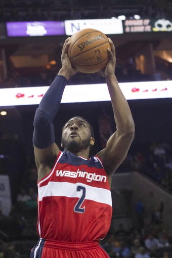 Mar 31, 2014; Charlotte, NC, USA; Washington Wizards guard John Wall (2) goes up for a shot against the Charlotte Bobcats during the first quarter at Time Warner Cable Arena. Mandatory Credit: Jeremy Brevard-USA TODAY Sports