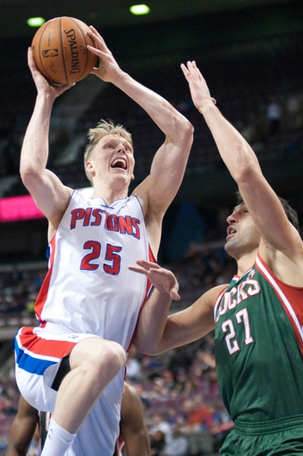 Mar 31, 2014; Auburn Hills, MI, USA; Detroit Pistons forward Kyle Singler (25) shoots the ball as Milwaukee Bucks center Zaza Pachulia (27) defends during the first quarter at The Palace of Auburn Hills. Mandatory Credit: Tim Fuller-USA TODAY Sports