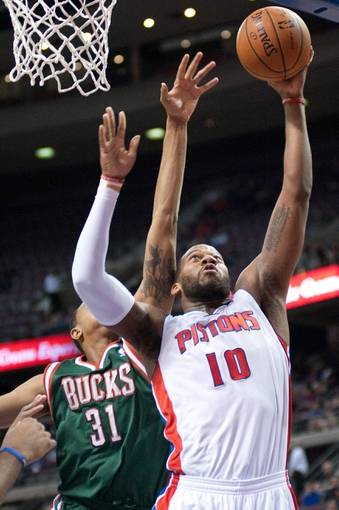 Mar 31, 2014; Auburn Hills, MI, USA; Detroit Pistons forward Greg Monroe (10) shoots the ball during the first quarter against the Milwaukee Bucks at The Palace of Auburn Hills. Mandatory Credit: Tim Fuller-USA TODAY Sports