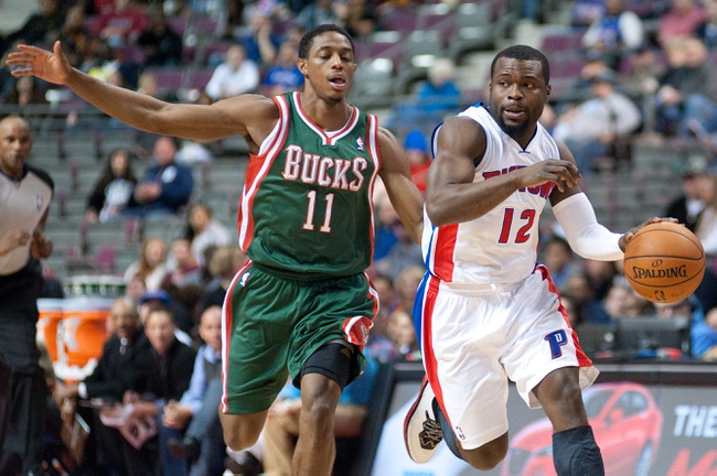 Mar 31, 2014; Auburn Hills, MI, USA; Detroit Pistons guard Will Bynum (12) dribbles the ball as Milwaukee Bucks guard Brandon Knight (11) defends during the second quarter at The Palace of Auburn Hills. Mandatory Credit: Tim Fuller-USA TODAY Sports