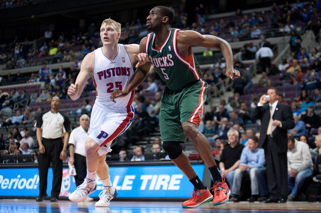 Mar 31, 2014; Auburn Hills, MI, USA; Milwaukee Bucks forward Ekpe Udoh (5) battles for position with Detroit Pistons forward Kyle Singler (25) during the first quarter at The Palace of Auburn Hills. Mandatory Credit: Tim Fuller-USA TODAY Sports