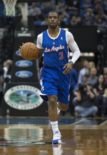 Mar 31, 2014; Minneapolis, MN, USA; Los Angeles Clippers guard Chris Paul (3) dribbles the ball down the court in the first half against the Minnesota Timberwolves at Target Center. Mandatory Credit: Jesse Johnson-USA TODAY Sports
