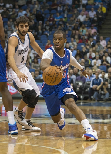 Mar 31, 2014; Minneapolis, MN, USA; Los Angeles Clippers guard Chris Paul (3) drives to the basket past Minnesota Timberwolves guard Ricky Rubio (9) in the first half at Target Center. Mandatory Credit: Jesse Johnson-USA TODAY Sports