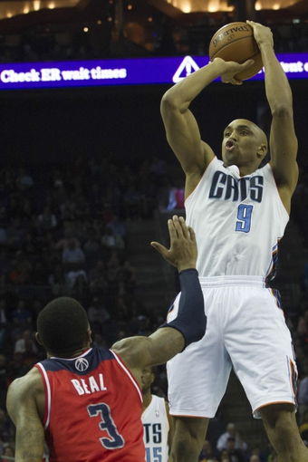 Mar 31, 2014; Charlotte, NC, USA; Charlotte Bobcats guard Gerald Henderson (9) shoots a three point shot over Washington Wizards guard Bradley Beal (3) during the second half at Time Warner Cable Arena. Bobcats defeated the Wizards 100-94. Mandatory Credit: Jeremy Brevard-USA TODAY Sports