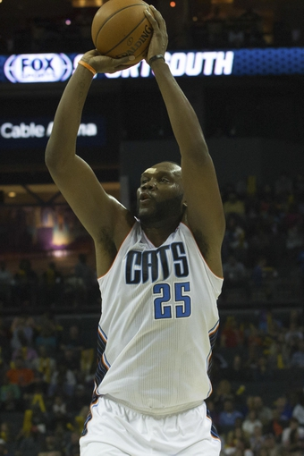 Mar 31, 2014; Charlotte, NC, USA; Charlotte Bobcats center Al Jefferson (25) shoots the ball during the second half against the Washington Wizards at Time Warner Cable Arena. Bobcats defeated the Wizards 100-94. Mandatory Credit: Jeremy Brevard-USA TODAY Sports