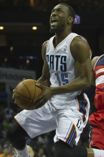 Mar 31, 2014; Charlotte, NC, USA; Charlotte Bobcats guard Kemba Walker (15) goes up for a shot during the second half against the Washington Wizards at Time Warner Cable Arena. Bobcats defeated the Wizards 100-94. Mandatory Credit: Jeremy Brevard-USA TODAY Sports