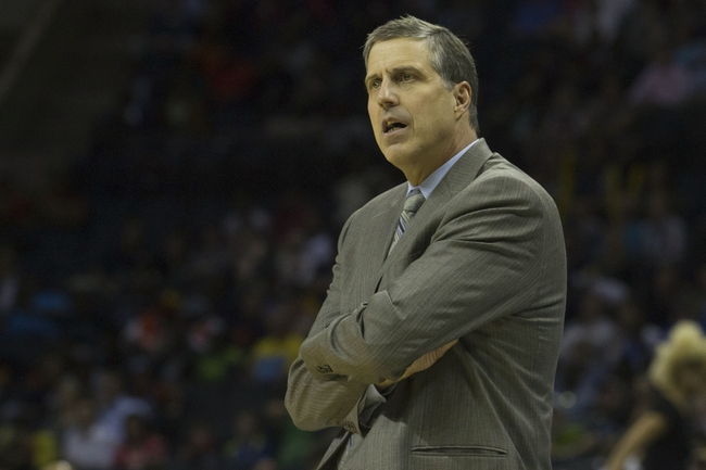 Mar 31, 2014; Charlotte, NC, USA; Washington Wizards head coach Randy Wittman reacts to a call during the second half against the Charlotte Bobcats at Time Warner Cable Arena. Bobcats defeated the Wizards 100-94. Mandatory Credit: Jeremy Brevard-USA TODAY Sports