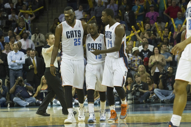 Mar 31, 2014; Charlotte, NC, USA; Charlotte Bobcats center Al Jefferson (25), guard Kemba Walker (15), and forward Michael Kidd-Gilchrist (14) reacts after a turnover during the second half against the Washington Wizards at Time Warner Cable Arena. Bobcats defeated the Wizards 100-94. Mandatory Credit: Jeremy Brevard-USA TODAY Sports