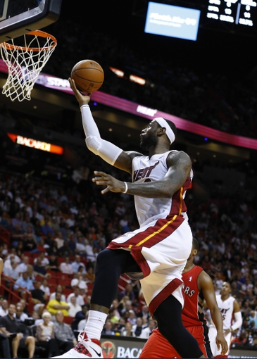 Mar 31, 2014; Miami, FL, USA; Miami Heat forward LeBron James (6) makes a basket against the Toronto Raptors in the second half at American Airlines Arena. The Heat won 93-83. Mandatory Credit: Robert Mayer-USA TODAY Sports