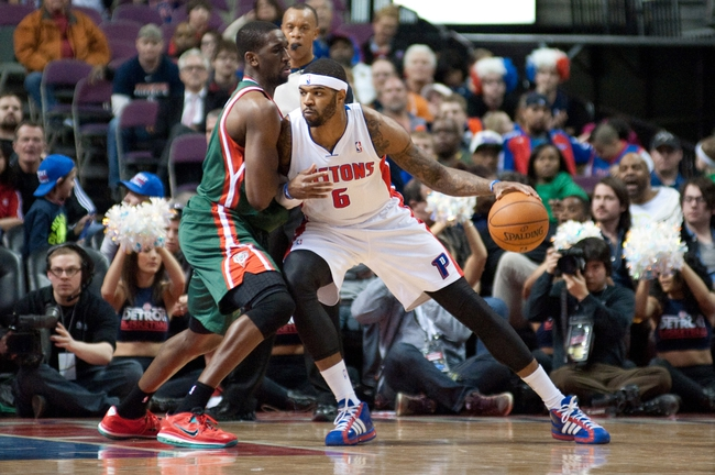 Mar 31, 2014; Auburn Hills, MI, USA; Detroit Pistons forward Josh Smith (6) dribbles the ball during the fourth quarter against the Milwaukee Bucks at The Palace of Auburn Hills. Pistons won 116-111. Mandatory Credit: Tim Fuller-USA TODAY Sports