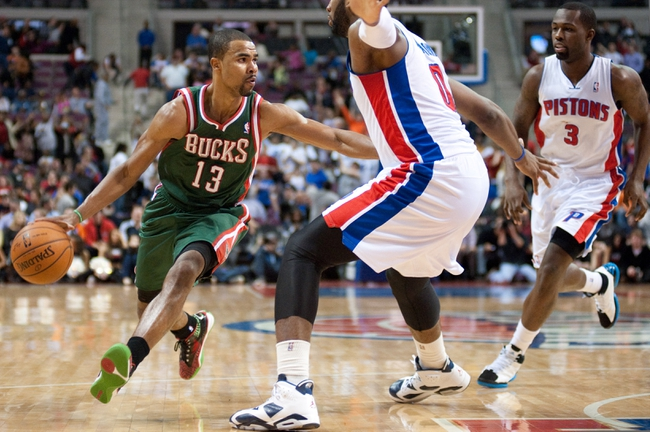 Mar 31, 2014; Auburn Hills, MI, USA; Milwaukee Bucks guard Ramon Sessions (13) dribbles the ball as Detroit Pistons center Andre Drummond (0) defneds during the third quarter at The Palace of Auburn Hills. Pistons won 116-111. Mandatory Credit: Tim Fuller-USA TODAY Sports