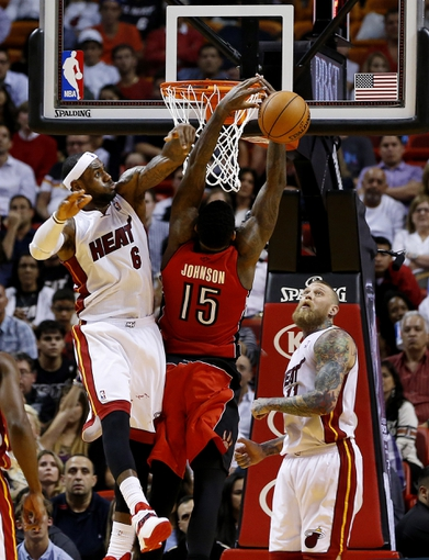 Mar 31, 2014; Miami, FL, USA; Miami Heat forward LeBron James (6) is called for a foul on Toronto Raptors forward Amir Johnson (15) in the second half at American Airlines Arena. The Heat won 93-83. Mandatory Credit: Robert Mayer-USA TODAY Sports