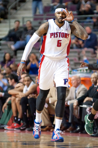 Mar 31, 2014; Auburn Hills, MI, USA; Detroit Pistons forward Josh Smith (6) celebrates after scoring during the fourth quarter against the Milwaukee Bucks at The Palace of Auburn Hills. Pistons won 116-111. Mandatory Credit: Tim Fuller-USA TODAY Sports