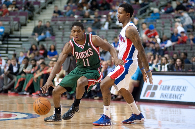 Mar 31, 2014; Auburn Hills, MI, USA; Milwaukee Bucks guard Brandon Knight (11) dribbles the ball around Detroit Pistons guard Brandon Jennings (7) during the third quarter at The Palace of Auburn Hills. Pistons won 116-111. Mandatory Credit: Tim Fuller-USA TODAY Sports