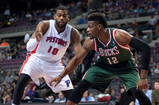 Mar 31, 2014; Auburn Hills, MI, USA; Milwaukee Bucks forward Jeff Adrien (12) defends Detroit Pistons forward Greg Monroe (10) during the first quarter at The Palace of Auburn Hills. Mandatory Credit: Tim Fuller-USA TODAY Sports