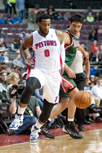 Mar 31, 2014; Auburn Hills, MI, USA; Milwaukee Bucks center Zaza Pachulia (27) battles for the ball with Detroit Pistons center Andre Drummond (0) during the first quarter at The Palace of Auburn Hills. Mandatory Credit: Tim Fuller-USA TODAY Sports