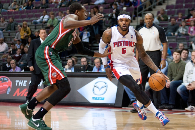 Mar 31, 2014; Auburn Hills, MI, USA; Detroit Pistons forward Josh Smith (6) dribbles the ball in front of Milwaukee Bucks forward Khris Middleton (22) during the first quarter at The Palace of Auburn Hills. Mandatory Credit: Tim Fuller-USA TODAY Sports