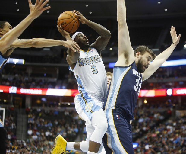 Mar 31, 2014; Denver, CO, USA; Denver Nuggets guard Ty Lawson (3) shoots the ball over Memphis Grizzlies Marc Gasol (33) during the first half at Pepsi Center. Mandatory Credit: Chris Humphreys-USA TODAY Sports