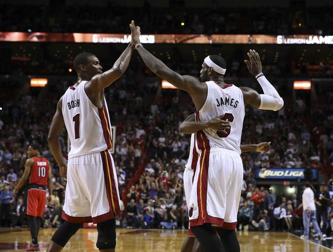 Mar 31, 2014; Miami, FL, USA; Miami Heat center Chris Bosh (1) and Miami Heat forward LeBron James (6) react in the second half of a game against the Toronto Raptors at American Airlines Arena. The Heat won 93-83. Mandatory Credit: Robert Mayer-USA TODAY Sports