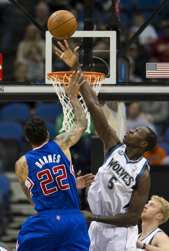 Mar 31, 2014; Minneapolis, MN, USA; Minnesota Timberwolves center Gorgui Dieng (5) attempts to block a shot from Los Angeles Clippers forward Matt Barnes (22) in the second half at Target Center. The Clippers won 114-104. Mandatory Credit: Jesse Johnson-USA TODAY Sports