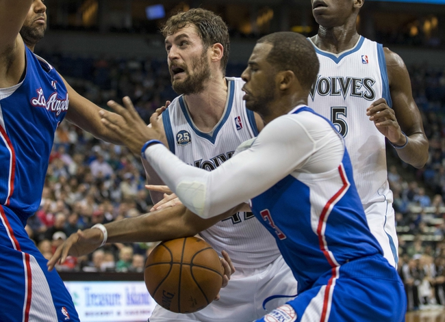 Mar 31, 2014; Minneapolis, MN, USA; Los Angeles Clippers guard Chris Paul (3) knocks the ball loose from Minnesota Timberwolves forward Kevin Love (42) in the second half at Target Center. The Clippers won 114-104. Mandatory Credit: Jesse Johnson-USA TODAY Sports