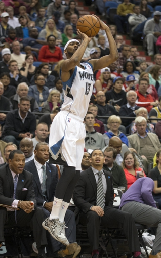 Mar 31, 2014; Minneapolis, MN, USA; Minnesota Timberwolves forward Corey Brewer (13) goes up for a shot in the second half against the Los Angeles Clippers at Target Center. The Clippers won 114-104. Mandatory Credit: Jesse Johnson-USA TODAY Sports