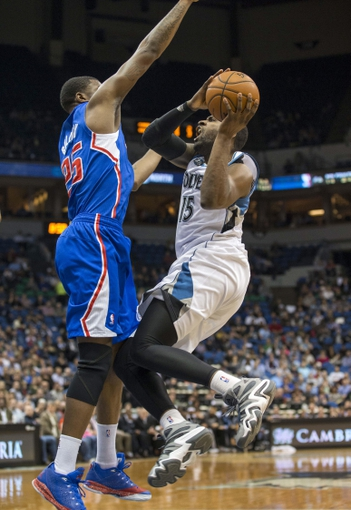 Mar 31, 2014; Minneapolis, MN, USA; Minnesota Timberwolves forward Shabazz Muhammad (15) drives to the basket past Los Angeles Clippers guard Reggie Bullock (25) in the second half at Target Center. The Clippers won 114-104. Mandatory Credit: Jesse Johnson-USA TODAY Sports