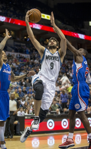 Mar 31, 2014; Minneapolis, MN, USA; Minnesota Timberwolves guard Ricky Rubio (9) goes up for a layup in the second half against the Los Angeles Clippers at Target Center. The Clippers won 114-104. Mandatory Credit: Jesse Johnson-USA TODAY Sports
