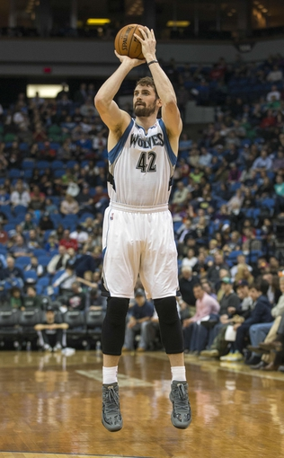 Mar 31, 2014; Minneapolis, MN, USA; Minnesota Timberwolves forward Kevin Love (42) goes up for a shot in the second half against the Los Angeles Clippers at Target Center. The Clippers won 114-104. Mandatory Credit: Jesse Johnson-USA TODAY Sports