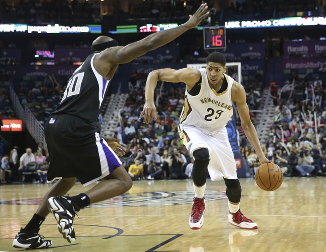 Mar 31, 2014; New Orleans, LA, USA; New Orleans Pelicans forward Anthony Davis (23) is defended by Sacramento Kings forward Reggie Evans (30) as he drives toward the basket in the second half at the Smoothie King Center. Sacramento defeated New Orleans 102-97. Mandatory Credit: Crystal LoGiudice-USA TODAY Sports