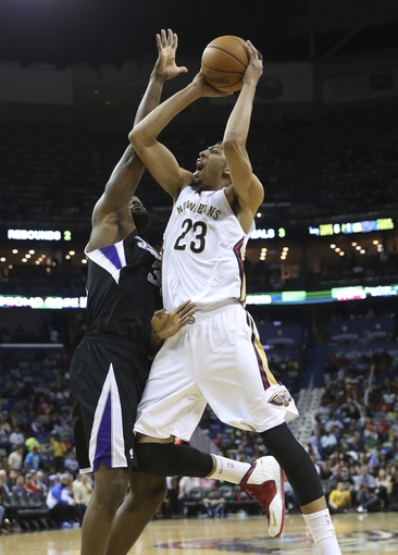 Mar 31, 2014; New Orleans, LA, USA; New Orleans Pelicans forward Anthony Davis (23) is defended by Sacramento Kings forward Reggie Evans (30) as he attempts a basket in the second half at the Smoothie King Center. Sacramento defeated New Orleans 102-97. Mandatory Credit: Crystal LoGiudice-USA TODAY Sports