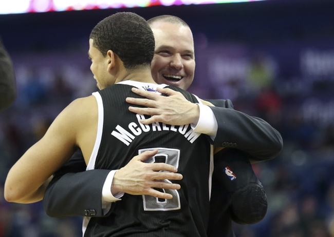 Mar 31, 2014; New Orleans, LA, USA; Sacramento Kings head coach Michael Malone hugs guard Ray McCallum (3) after the Kings defeated the New Orleans Pelicans 102-97 at the Smoothie King Center. Mandatory Credit: Crystal LoGiudice-USA TODAY Sports
