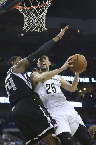 Mar 31, 2014; New Orleans, LA, USA; New Orleans Pelicans guard Austin Rivers (25) is defended under the basket by Sacramento Kings forward Jason Thompson (34) in the second half at the Smoothie King Center. Sacramento defeated New Orleans 102-97. Mandatory Credit: Crystal LoGiudice-USA TODAY Sports