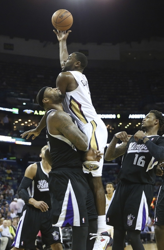Mar 31, 2014; New Orleans, LA, USA; New Orleans Pelicans forward Tyreke Evans (1) is defended by Sacramento Kings center DeMarcus Cousins (left) as he attempts a basket in the second half at the Smoothie King Center. Sacramento defeated New Orleans 102-97. Mandatory Credit: Crystal LoGiudice-USA TODAY Sports