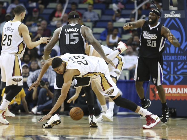 Mar 31, 2014; New Orleans, LA, USA; New Orleans Pelicans forward Anthony Davis (23) falls to the ground beside Sacramento Kings center DeMarcus Cousins (15) in the second half at the Smoothie King Center. Sacramento defeated New Orleans 102-97. Mandatory Credit: Crystal LoGiudice-USA TODAY Sports