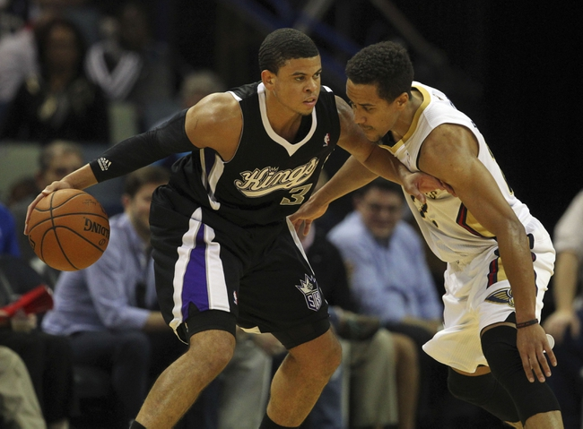 Mar 31, 2014; New Orleans, LA, USA; Sacramento Kings guard Ray McCallum (3) is defended by New Orleans Pelicans guard Brian Roberts (22) in the second half at the Smoothie King Center. Sacramento defeated New Orleans 102-97. Mandatory Credit: Crystal LoGiudice-USA TODAY Sports