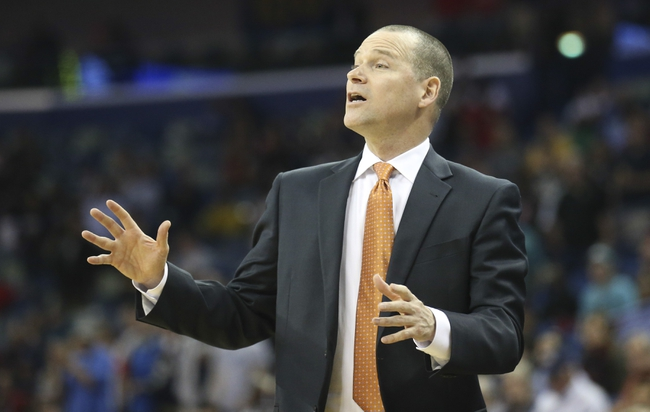 Mar 31, 2014; New Orleans, LA, USA; Sacramento Kings head coach Michael Malone motions to his team in the second half against the New Orleans Pelicans at the Smoothie King Center. Sacramento defeated New Orleans 102-97. Mandatory Credit: Crystal LoGiudice-USA TODAY Sports