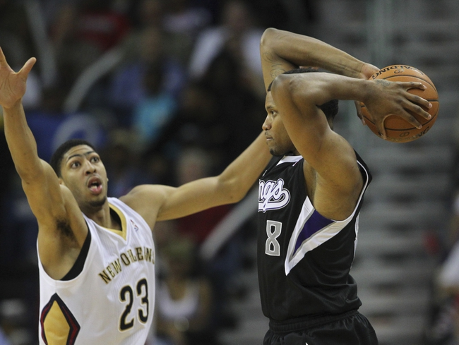 Mar 31, 2014; New Orleans, LA, USA; Sacramento Kings forward Rudy Gay (8) is defended by New Orleans Pelicans forward Anthony Davis (23) in the second half at the Smoothie King Center. Sacramento defeated New Orleans 102-97. Mandatory Credit: Crystal LoGiudice-USA TODAY Sports