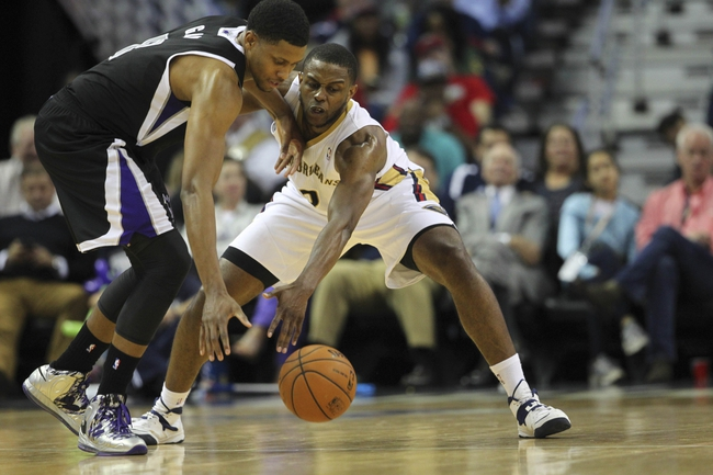 Mar 31, 2014; New Orleans, LA, USA; Sacramento Kings forward Rudy Gay (8) and New Orleans Pelicans forward Darius Miller (2) reach for the ball in the second half at the Smoothie King Center. Sacramento defeated New Orleans 102-97. Mandatory Credit: Crystal LoGiudice-USA TODAY Sports