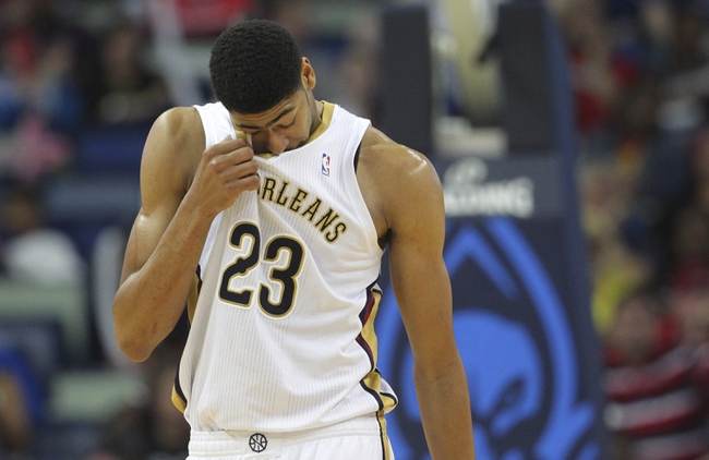 Mar 31, 2014; New Orleans, LA, USA; New Orleans Pelicans forward Anthony Davis (23) wipes his face after taking an elbow to the face by Sacramento Kings forward Reggie Evans (not pictured) in the second half at the Smoothie King Center. Sacramento defeated New Orleans 102-97. Mandatory Credit: Crystal LoGiudice-USA TODAY Sports