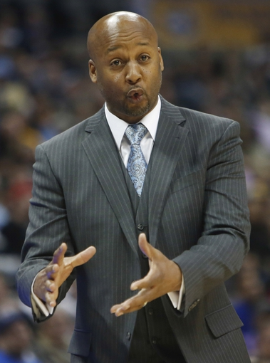 Mar 31, 2014; Denver, CO, USA; Denver Nuggets coach Brian Shaw reacts during the first half against the Memphis Grizzlies at Pepsi Center. Mandatory Credit: Chris Humphreys-USA TODAY Sports