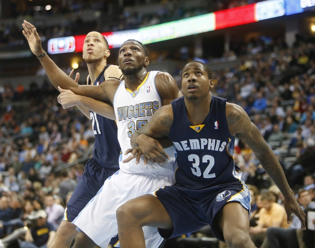 Mar 31, 2014; Denver, CO, USA; Denver Nuggets forward Kenneth Faried (35) is blocked out by Memphis Grizzlies forward Ed Davis (32) and forward Tayshaun Prince (21) during the first half at Pepsi Center. Mandatory Credit: Chris Humphreys-USA TODAY Sports