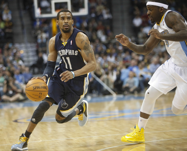 Mar 31, 2014; Denver, CO, USA; Memphis Grizzlies guard Mike Conley (11) drives to the basket past Denver Nuggets guard Ty Lawson (3) during the second half at Pepsi Center.  The Grizzlies won 94-92.  Mandatory Credit: Chris Humphreys-USA TODAY Sports