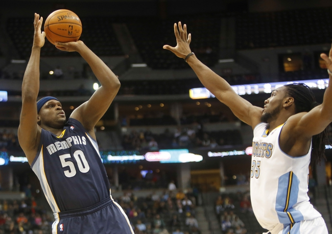 Mar 31, 2014; Denver, CO, USA; Memphis Grizzlies forward Zah Randolph (50) shoots the ball over Denver Nuggets forward Kenneth Faried (35) during the second half at Pepsi Center.  The Grizzlies won 94-92.  Mandatory Credit: Chris Humphreys-USA TODAY Sports