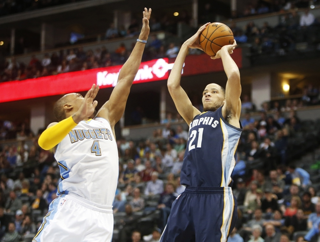 Mar 31, 2014; Denver, CO, USA; Memphis Grizzlies forward Tayshaun Prince (21) shoots the ball during the second half against the Denver Nuggets at Pepsi Center.  The Grizzlies won 94-92.  Mandatory Credit: Chris Humphreys-USA TODAY Sports