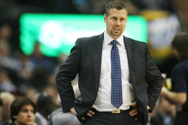 Mar 31, 2014; Denver, CO, USA; Memphis Grizzlies head coach David Joerger looks on during the second half against the Denver Nuggets at Pepsi Center.  The Grizzlies won 94-92.  Mandatory Credit: Chris Humphreys-USA TODAY Sports